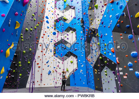 The new Earth Treks indoor rock climbing gym in Englewood, Colorado (suburb of Denver) USA; at 53,000 square feet is the largest rock climbing gym in  - Stock Photo