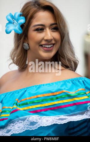 Chicago, Illinois , USA - September 9, 2018 The 26th Street Mexican Independence Parade, Mexican woman wearing traditional clothing dancing - Stock Photo
