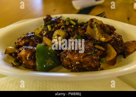 Indian famous fast food chilli chicken displayed in a restaurant - Stock Photo