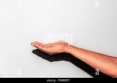Hand hold virtual objects, isolated on white background. Close up Hand and arm with clipping path. Can use for Show your product. Isolated - Stock Photo