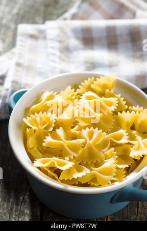 Farfalle pasta. Tasty italian pasta in pot. - Stock Photo