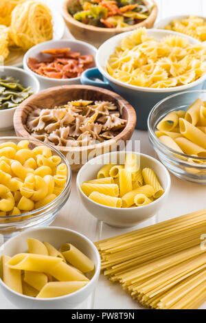 Various types of italian pasta in bowl. - Stock Photo