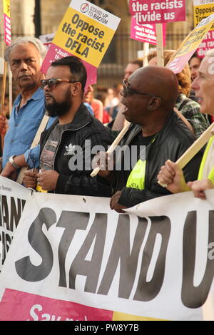 London, UK. 13th October, 2018. A counter protest organised by campaign group Stand Up To Racism included a march and rally in Whitehall. The purpose of the protest was to prevent the far right group DFLA (Democratic Football Lads Alliance) from marching through Whitehall and past Parliament. Roland Ravenhill/Alamy Live News - Stock Photo
