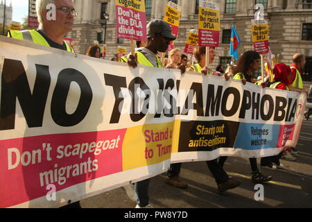 London, UK. 13th October, 2018. Campaign group Stand Up To Racism held a march and rally in Whitehall. The purpose of the protest was to prevent the far right group DFLA (Democratic Football Lads Alliance) from marching through Whitehall and past Parliament. Roland Ravenhill/Alamy Live News - Stock Photo