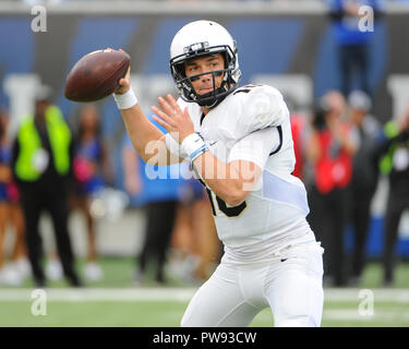 Memphis, TN, USA. 13th Oct, 2018. Central Florida quarterback, McKENZIE MILTON (10), loads up top throw during the NCAA football game between the Memphis Tigers and the Central Florida Knights at Liberty Bowl Stadium in Memphis, TN. UCF defeated Memphis, 31-30. Kevin Langley/CSM/Alamy Live News - Stock Photo