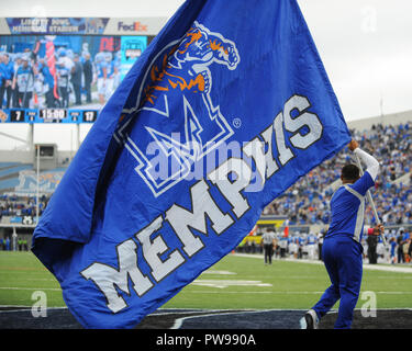 Memphis, TN, USA. 13th Oct, 2018. A Memphis Tigers male cheerleader flies the MEMPHIS TIGERS FLAG, during the NCAA football game between the Memphis Tigers and the Central Florida Knights at Liberty Bowl Stadium in Memphis, TN. UCF defeated Memphis, 31-30. Kevin Langley/CSM/Alamy Live News - Stock Photo