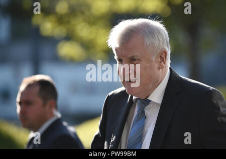 Munich, Bavaria, Germany. 14th Oct, 2018. 14 October 2018, Germany, Munich: Horst Seehofer (R), CSU Chairman and Federal Minister of the Interior, Construction and Home Affairs, comes to the CSU headquarters. Credit: Nicolas Armer/dpa/Alamy Live News Credit: dpa picture alliance/Alamy Live News - Stock Photo