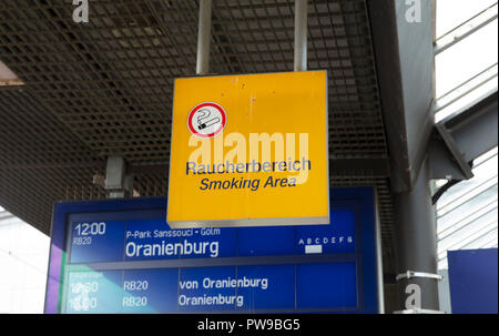 Potsdam, Berlin, Germany: 18th August 2018: smoking area sign at potsdam bahnhof - Stock Photo