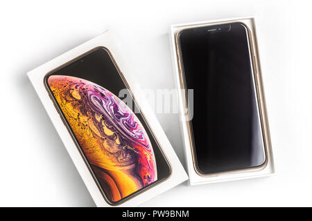 12th October,2018-Kiev,Ukraine: Latest Iphone XS in unopened box on white table. Newest Apple smartphone on white branded box in mobile store. Modern gadget with dual camera and OLED screen for sale - Stock Photo