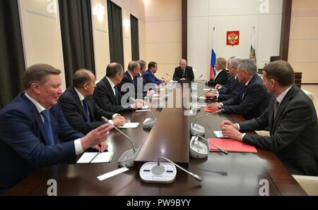 Russian President Vladimir Putin, center, chairs a meeting of the permanent members of the Security Council at the Presidents residence in Novo-Ogaryovo October 12, 2018 outside Moscow, Russia. - Stock Photo