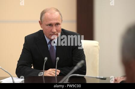 Russian President Vladimir Putin chairs a meeting of the permanent members of the Security Council at the Presidents residence in Novo-Ogaryovo October 12, 2018 outside Moscow, Russia. - Stock Photo