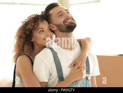 Happy married couple examines a new apartment - Stock Photo