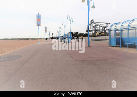 Skegness, Lincolnshire, UK. October 05, 2018. Holidaymakers enjoying a empty October promenade and beach at Skegness in Lincolnshire, UK. - Stock Photo