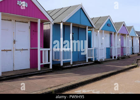 Sutton on Sea, Lincolnshire, UK.  October 07, 2018.  A selected part of a row of beach huts on the Promenade at Sutton on Sea in Lincolnshire, UK. - Stock Photo