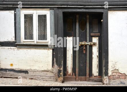 dilapidated half-timbered house in the old town of Wernigerode - Stock Photo