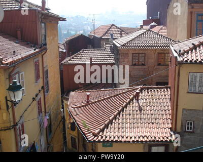 View over red tiled rooftops of the old town area of Porto, Portugal. - Stock Photo