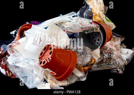 Pile of different plastics, some are recyclable some not. - Stock Photo