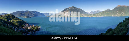 Panorama overlooking Lake Como and surrounding mountains in northern Italy - Stock Photo