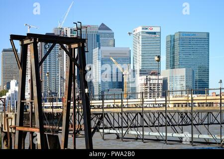 The Canary Wharf viewed from across the river Thames with an old industrial site in foreground, North Greenwich Docklands London England UK - Stock Photo