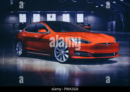 Berlin, August 29, 2018: Photo of the image of an electric vehicle Tesla at the Tesla motor show in Berlin. A modern electric car. - Stock Photo