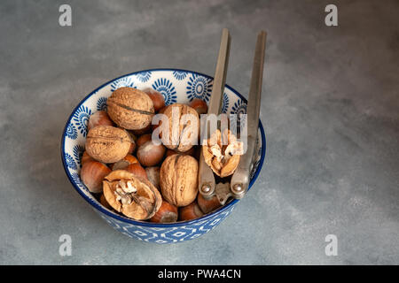 Different types of nuts in a bowl. - Stock Photo