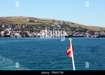 The NorthLink ferry Hamnavoe leaving Stromness on Orkney - Stock Photo