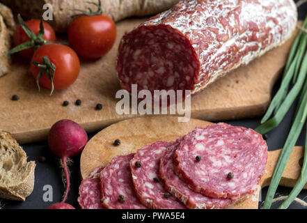Close up sausage pieces with bread and potatoes - Stock Photo