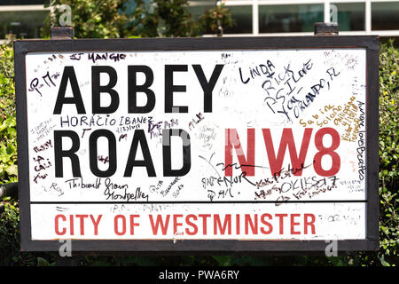 Graffiti on street sign, Abbey Road, St John's Wood, City of Westminster, Greater London, England, United Kingdom - Stock Photo