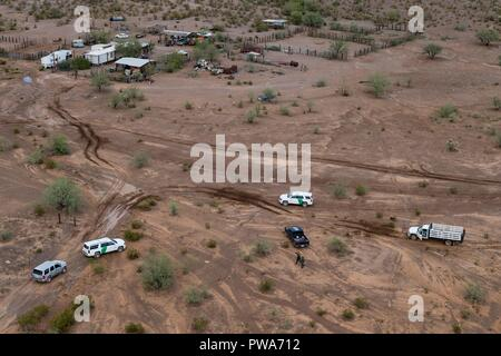 Roads covered with mud from flooding caused by heavy rains from Tropical Storm Rosa in the Tohono O'odham Indian Reservation October 3, 2018 in Ali Chuk, Arizona. - Stock Photo