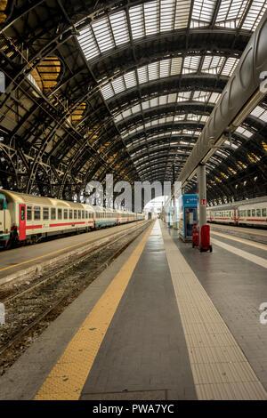 Milan Central Station - March 31: The platform of Milan central railway station on March 31, 2018 in Milan, Italy. The Milan railway station is the la - Stock Photo