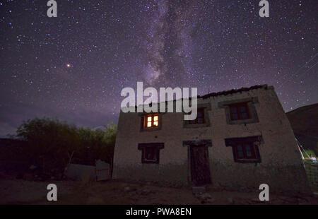 The Milky Way above a Tibetan home, Meerak village, Pangong Lake, Ladakh, India - Stock Photo