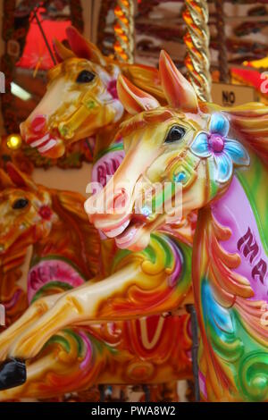 Close-up of carousel horses heads on the Victorian carousel at Albert Dock, Liverpool - Stock Photo