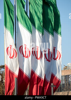 Islamic Republic of Iran flags waving in the wind - Stock Photo