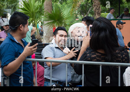 Follower holds a Puppet doll of Mexico's president Andres Manuel Lopez Obrador during his visit to Merida, Yucatan. October , 2018. - Stock Photo