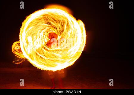 Fire dancers Swing fire dancing show fire show on the beach dance man juggling with fire - Stock Photo