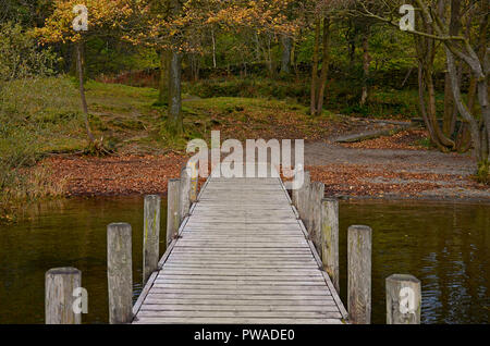Wood jetty on Coniston Water, Lake District, UK - Stock Photo