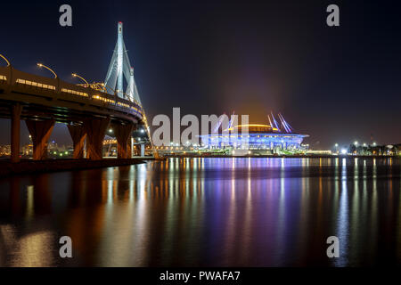 RUSSIA, SAINT PETERSBURG - September 24, 2017: The bridge along the Gulf of Finland and the football stadium Zenit Arena. - Stock Photo