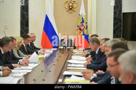 Russian President Vladimir Putin chairs a meeting of government members at the Kremlin October 11, 2018 in Moscow, Russia. - Stock Photo
