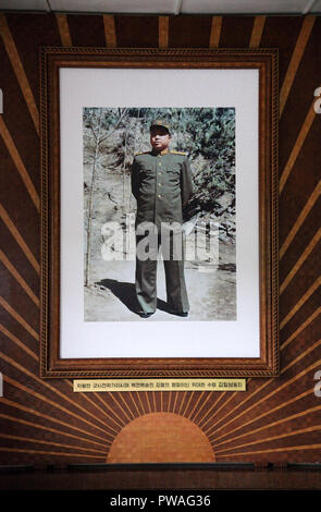 Photo of Kim Il Sung on display at the North Korean DMZ building - Stock Photo