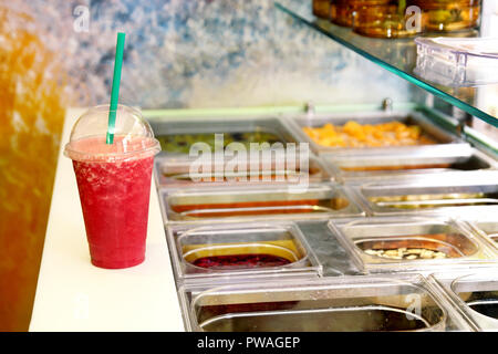 Fruit smoothie ready for sales in plastic cup with straw. Take away drinks concept. Fresh fruits juices at the public market. Various fresh fruit. - Stock Photo