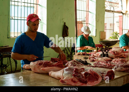 Meat Preparation in a Market in Sancti Spiritus, Cuba - Stock Photo