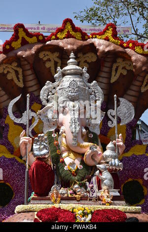 Ganesha idol (Tulsibaug mandal) in a procession in Pune City - Stock Photo