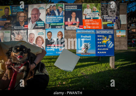 Political posters from parties running in the Bavarian Election. On the border with Austria the German town of Kiefersfelden, Bavaria, Germany. - Stock Photo