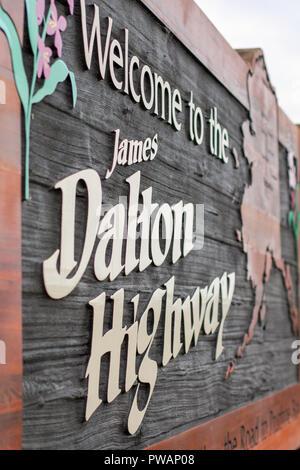 Dalton Highway, Alaska. Dalton Highway welcoming wooden sign with Alaska map. - Stock Photo
