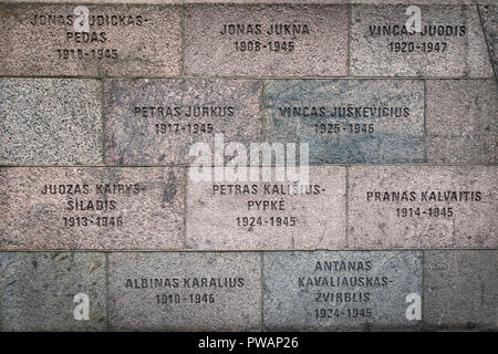 The Names of Lithuanians murdered during the Soviet and Nazi occupations inscribed on the exterior wall of the Museum Of Genocide Victims in Vilnius. - Stock Photo
