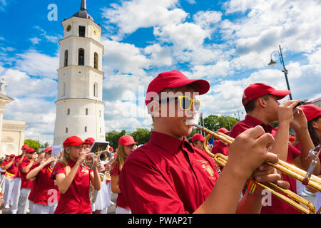 Vilnius festival, view of a young people's marching band parading through Cathedral Square in the Lithuanian Song and Dance Festival, Vilnius Old Town. - Stock Photo