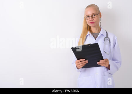 Beautiful blond woman doctor wearing eyeglasses against white ba - Stock Photo
