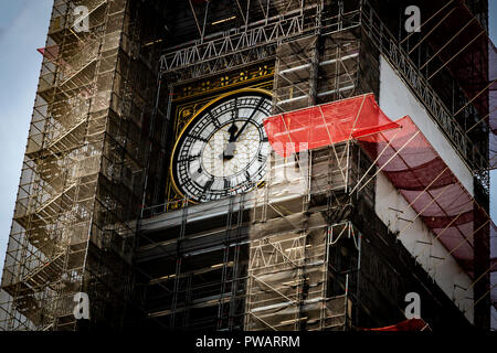 Big Ben clock still working while the tower is covered in scaffolding during refurbishment of the Houses of Parliament, London, UK - Stock Photo