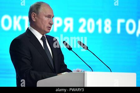 Russian President Vladimir Putin addresses the Fifth Forum of Russian and Belarusian Regions October 12, 2018 in Mogilev, Belarus. - Stock Photo