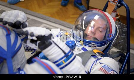 Expedition 57 Flight Engineer Nick Hague of NASA has his Sokol suit pressure checked ahead of his launch on a Soyuz rocket with Flight Engineer Alexey Ovchinin of Roscosmos, at the Baikonur Cosmodrome October 11, 2018 in Baikonur, Kazakhstan. Shortly after lift off the rocket malfunctioned en route to the International Space Station and aborted forcing an emergency landing in Kazakhstan. The crew members have been picked up by search and rescue and are reportedly in good condition. - Stock Photo